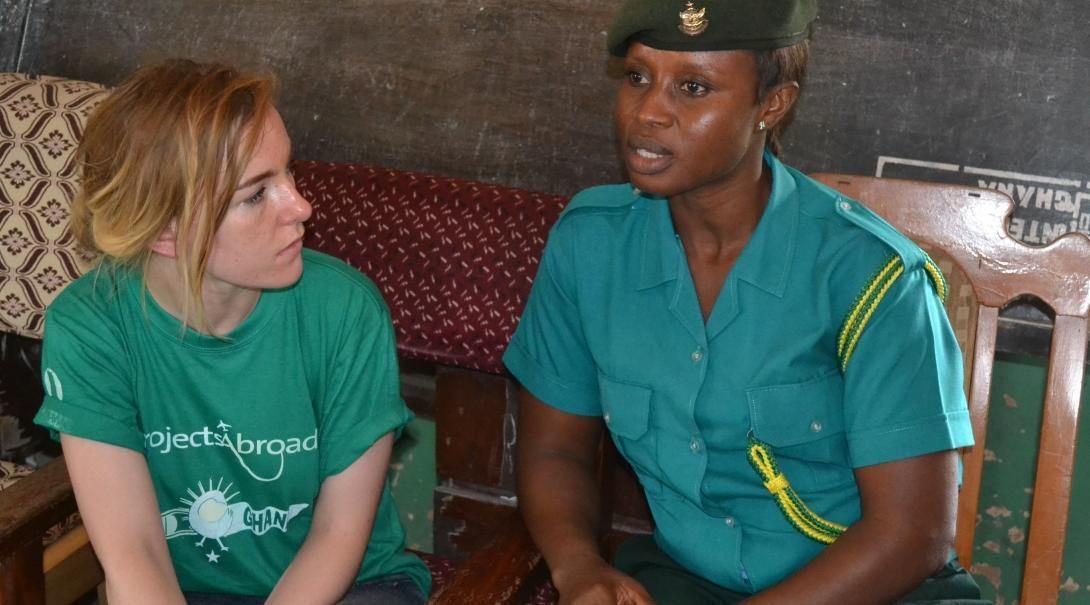 A student talks to an immigration officer during her Human Rights internship in Ghana.